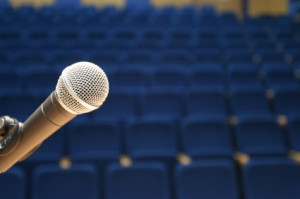 audio'connell voice over talent_microphone on stage
